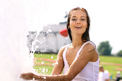 Sexy woman bathes in a city fountain Royalty Free Stock Images