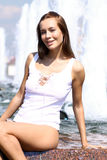 woman bathes in a city fountain Stock Photography