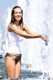 Sexy woman bathes in a city fountain Stock Photos