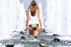 sexy woman bathes in a city fountain Royalty Free Stock Photos
