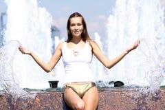 sexy woman bathes in a city fountain Stock Photo