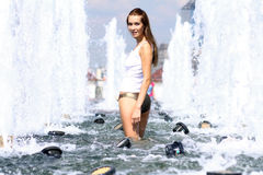 Sexy woman bathes in a city fountain Royalty Free Stock Photo