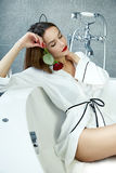 woman in bathroom in silk robe rose Valentine's day Stock Image