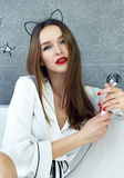 Sexy woman in bathroom in silk robe rose Valentine's day Stock Photos