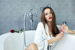 Sexy woman in bathroom in silk robe rose Valentine's day Royalty Free Stock Image