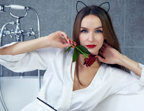 Sexy woman in bathroom in silk robe rose Valentine's day Royalty Free Stock Photos
