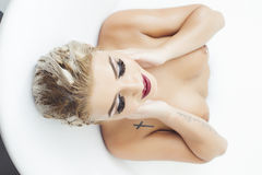Sexy woman in bathtub Stock Image