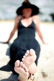 Woman at the Beach. A woman relaxing at the beach royalty free stock photography