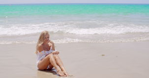 Sexy Woman at the Beach Smiling at the Camera stock video
