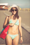 Sexy woman on beach vacation with accessories Stock Photos