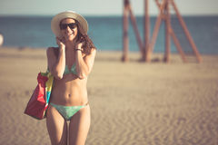 woman on beach vacation with accessories Stock Images