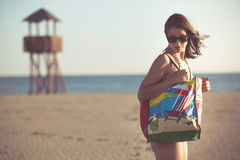 Sexy woman on beach vacation with accessories.Beach accessory.Going to the sandy beach vacation.Summer beach fashion style Stock Photography