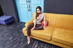 Sexy woman beauty makeup wear lather skinny pants cashmere wool Stock Photo