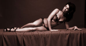 Sexy woman on bed Royalty Free Stock Photos