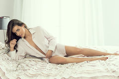 Sexy woman on bed Royalty Free Stock Image