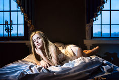 Sexy woman in the bed Royalty Free Stock Photos