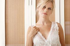 woman in bedroom wearing nighty. Royalty Free Stock Photos