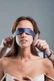 Sexy woman being blindfolded by man Royalty Free Stock Photos