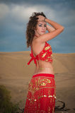 Sexy woman belly dancer arabian in desert dunes. At the afternoon Stock Photo