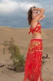 Sexy woman belly dancer arabian in desert dunes Stock Photography