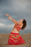 Sexy woman belly dancer arabian in desert dunes. At the afternoon Royalty Free Stock Photo
