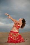Sexy woman belly dancer arabian in desert dunes Royalty Free Stock Photo