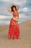 Sexy woman belly dancer arabian in desert dunes Royalty Free Stock Photos
