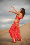 Sexy woman belly dancer arabian in desert dunes Stock Photos