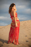 Sexy woman belly dancer arabian in desert dunes Stock Photo
