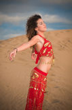 Sexy woman belly dancer arabian in desert dunes Stock Images