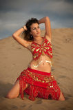 Sexy woman belly dancer arabian in desert dunes Royalty Free Stock Image
