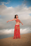 Sexy woman belly dancer arabian in desert dunes Royalty Free Stock Photos