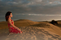 Sexy woman belly dancer arabian in desert dunes Royalty Free Stock Images