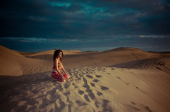Sexy woman belly dancer arabian in desert dunes Stock Photography