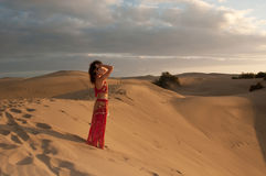 Sexy woman belly dancer arabian in desert dunes Royalty Free Stock Photography
