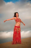 Sexy woman belly dancer arabian in desert dunes. At the afternoon Royalty Free Stock Photos