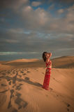 Sexy woman belly dancer arabian in desert dunes Royalty Free Stock Photo