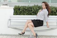 Sexy woman on a bench Royalty Free Stock Photos