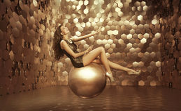 Sexy woman on the big ball Royalty Free Stock Image