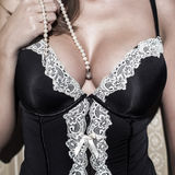 Sexy woman with big tits holding pearls Royalty Free Stock Photos