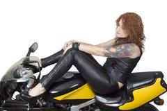 Sexy woman on a bike Stock Photos