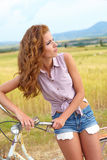 Sexy woman with bike Stock Image