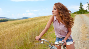 Sexy woman with bike Stock Photos