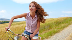 Sexy woman with bike Royalty Free Stock Photos