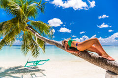 Sexy woman in bikini on the beach, summer travel holiday background in Maldives. Woman watching the sea from the pool in Maldives Stock Image