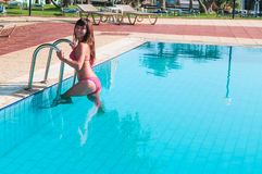 Sexy woman in bikini get out from pool Royalty Free Stock Photography