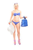 Sexy woman in bikini holding a blue purse Stock Photography