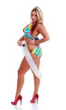 Sexy woman in a bikini holding a sash. Isolated sexy woman in a bikini holding a sash on a white background Stock Photos