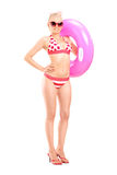 woman in bikini holding a swimming ring Stock Images