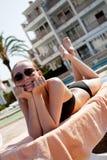 Sexy woman in bikini relax on sunlounger sunbathing Royalty Free Stock Photo